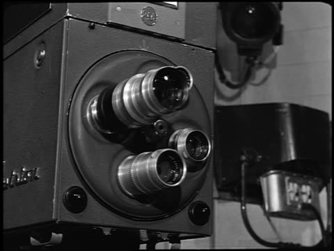 b/w 1940s/50s close up rotating lens turret on early television camera - fernsehkamera stock-videos und b-roll-filmmaterial