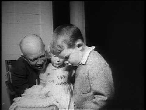 B/W 1940s/50s Dwight Eisenhower laughing sitting with grandchildren tasting birthday cake