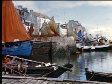 1940s/50s pan fishing boats in harbor + fishermen working on dock / france - frankreich stock-videos und b-roll-filmmaterial