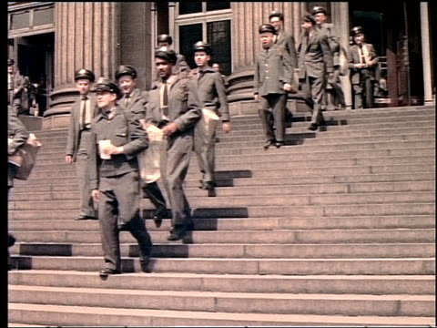 1940s/50s low angle large group of mailmen walking down steps of post office in new york city - uniform stock videos & royalty-free footage