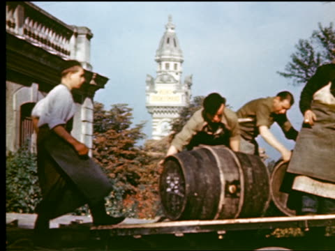 1940s/50s PAN men rolling barrels down ramp / ornate white building in background / (Epernay?) France