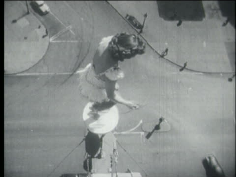 b/w 1940s/50s overhead woman in spangled outfit jumping rope on pedestal over city street - stunt person stock videos & royalty-free footage