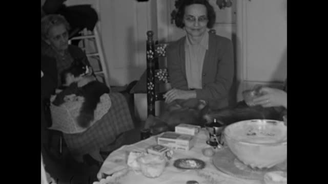 1950s Adults at dinner table smoking and eating - Home Movie