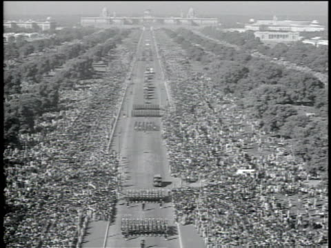 stockvideo's en b-roll-footage met 1950s aerial indian army marching in parade with large crowd watching / india - indiase leger
