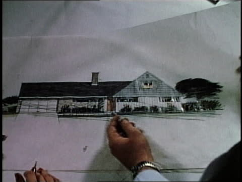 1950s WS architect sketching design for single family home / Levittown, Pennsylvania, United States