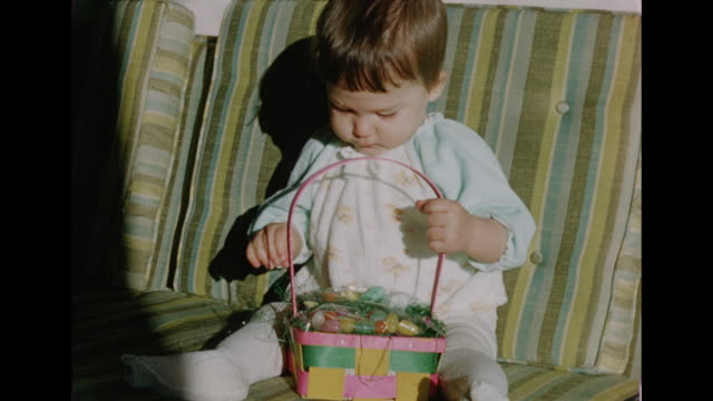 1950s Baby girl with an Easter basket
