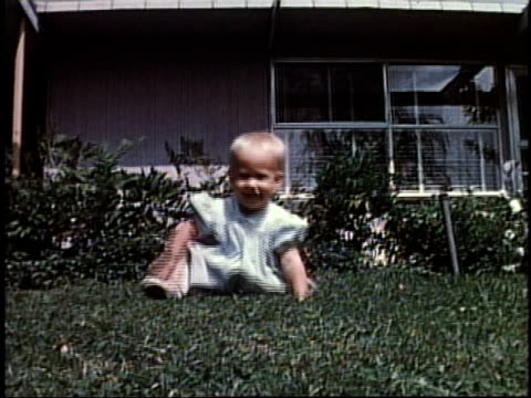 1950s ws baby sitting on lawn / levittown, pennsylvania, united states - levittown pennsylvania stock videos and b-roll footage