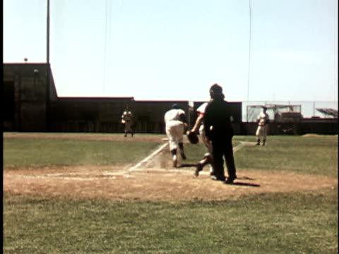 1950s ws, berkeley baseball player hitting ball and running to first base 1950's, berkeley, california, usa - baseballmannschaft stock-videos und b-roll-filmmaterial