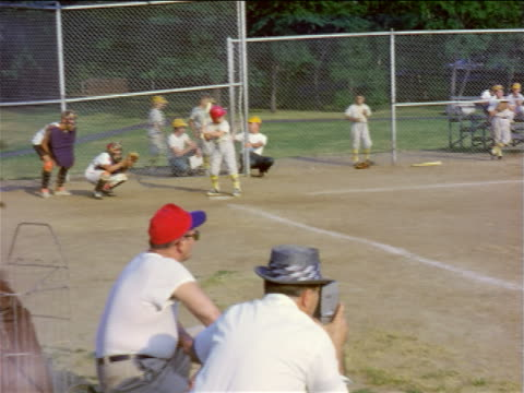 1950s boy at bat in little league game / almost hit by ball / home movie - youth baseball and softball league stock videos and b-roll footage