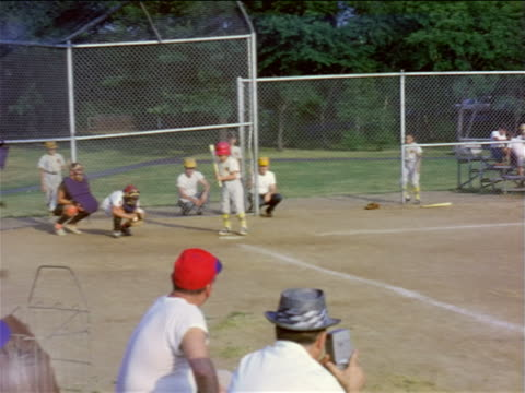 1950s boy at bat in little league game / doesn't swing at pitch / home movie - baseball bat stock videos & royalty-free footage