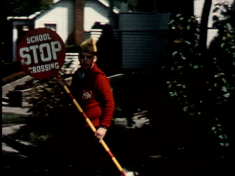 1950s ms, boy (12-13) in junior police uniform holding stop sign on street, berkeley, california, usa - stop sign stock videos & royalty-free footage