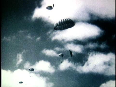1950s b/w ws french paratroopers landing in countryside during the french indochina war / vietnam - indocina video stock e b–roll