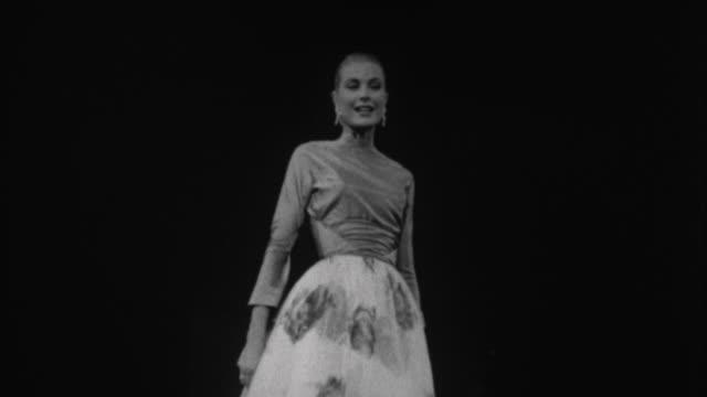 1950s B/W MS LA Grace Kelly working as model / Los Angeles California USA