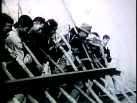 1950s b/w montage group of viet cong members disassembling train track / north vietnam - north vietnam stock videos & royalty-free footage