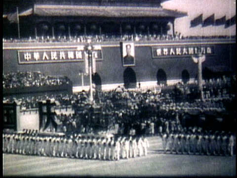 1950s b/w montage mao zedong and nikita khrushchev watching chinese parade rally from reviewing stand / beijing china - 1958 stock videos & royalty-free footage