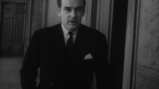 1950s B/W CU Prince Rainier III walking indoors / Los Angeles California USA