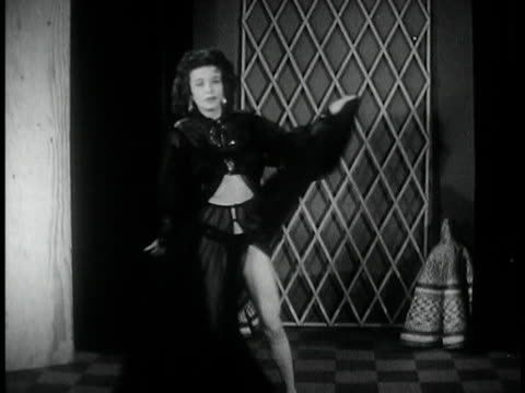 vídeos de stock, filmes e b-roll de 1950s b/w ws zi woman dancing in striptease act/ usa - despindo se