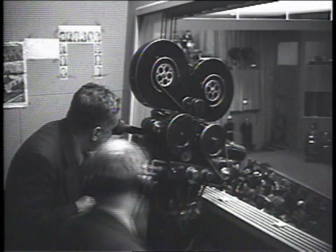 vidéos et rushes de 1950s cameramen working in press booth at united nations meeting/ new york, new york, united states - caméraman