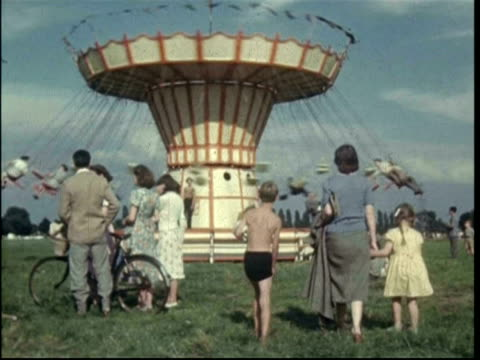1950s chertsey regatta funfair; flying chair carousel, various rides; vee stammers, susie day and peter day - fairground stock videos and b-roll footage