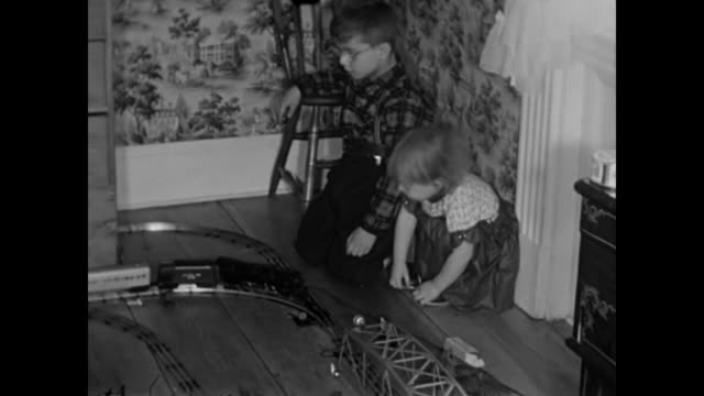 1950s children playing with locomotive train - home movie - 1950 stock videos and b-roll footage