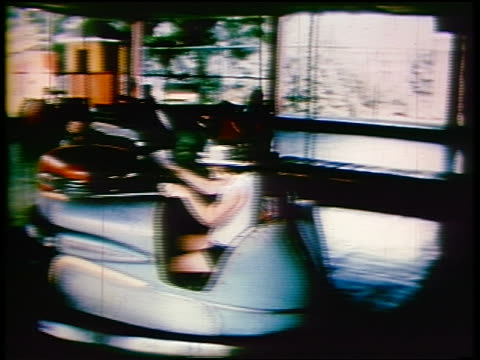 1950s pan children riding bumper car ride at amusement park - bumper car stock videos & royalty-free footage