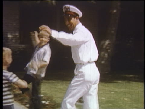 1950s children running up to join jolly milkman making delivery / educational - milkman stock videos & royalty-free footage