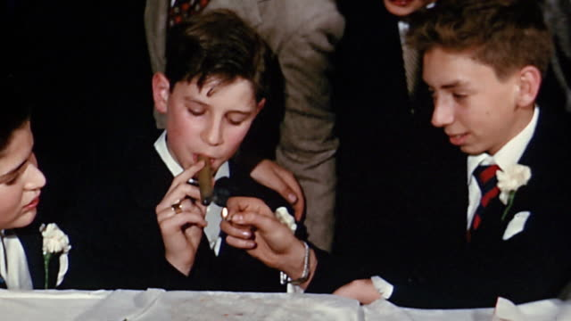 vídeos de stock, filmes e b-roll de 1950s close up boy lighting cigar other boy / boy smokes cigar - abundância