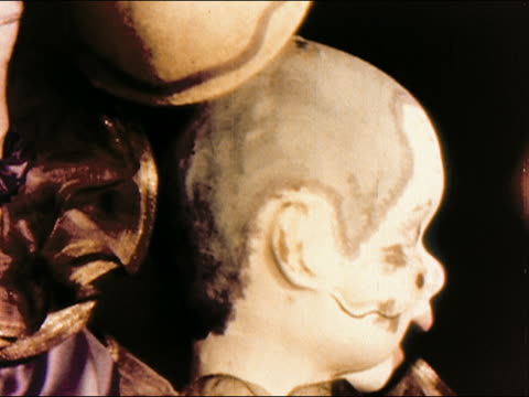 1950s close up cracked face of animatronic puppet lifting hat / coney island / brooklyn, new york / audio - puppet stock videos and b-roll footage