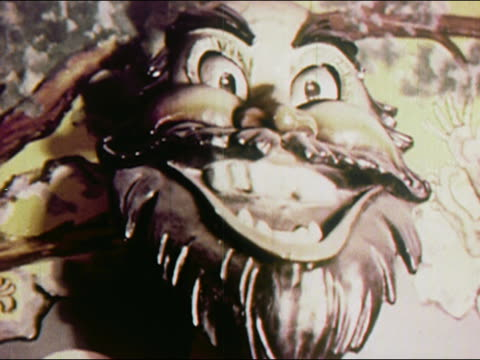 1950s close up eyes and mouth moving on animatronic sculpture of face / coney island, brooklyn, new york / audio - coney island stock-videos und b-roll-filmmaterial