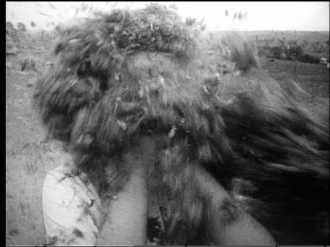 b/w 1950s close up feathers being thrown over woman's head at pillow fight outdoors - pillow fight stock videos & royalty-free footage