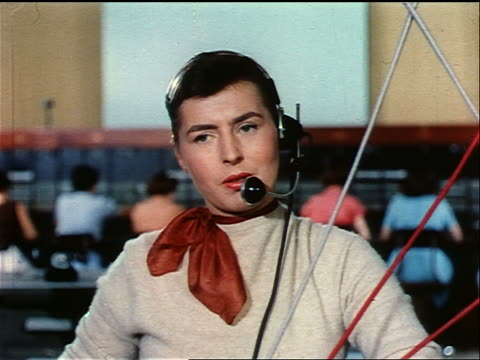 1950s close up female telephone operator talking into headset