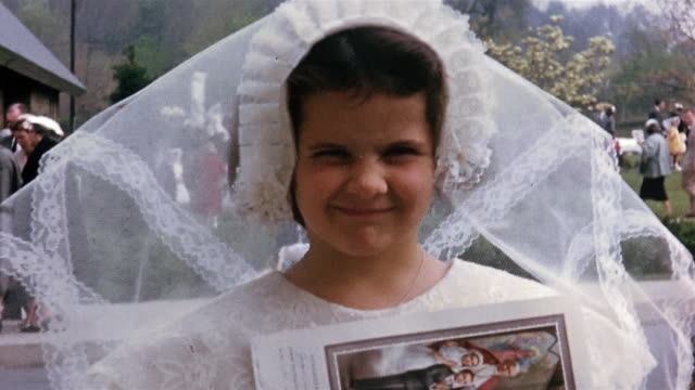 1950s close up girl in communion veil and dress smiling at cam - one girl only stock videos & royalty-free footage