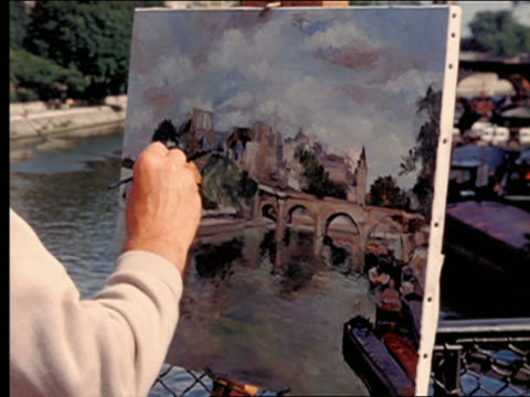 1950s close up man's hand painting seine river, ile de la cite + pont-neuf on canvas / paris, france - river seine stock videos & royalty-free footage