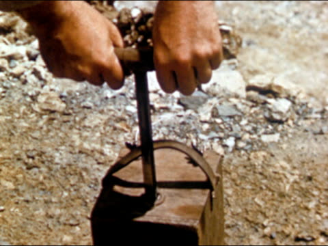 1950s close up of hands plunging dynamite detonator / audio - explosive stock videos & royalty-free footage