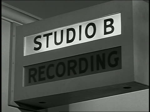 1950s close up recording studio sign lights up