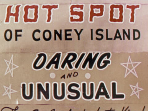 "1950s close up sign reading ""hot spot of coney island / daring and unusual"" / brooklyn, new york / audio - coney island stock-videos und b-roll-filmmaterial"