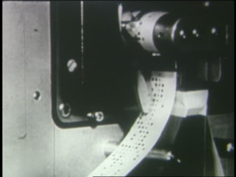 b/w 1950s close up tape with code spooling from computer - punch card stock videos & royalty-free footage