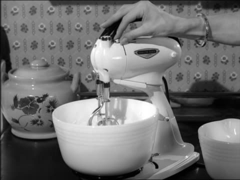 b/w 1950s close up woman's hand turning on electric mixer - food processor stock videos and b-roll footage