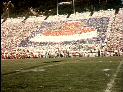 1950s WS, COMPOSITE, Audience in California Memorial Stadium making designs with colored boards, Berkeley, California, USA