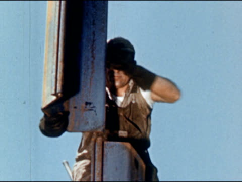 1950s construction worker aligning steel joints of bridge / usa / audio - bridge built structure stock videos and b-roll footage