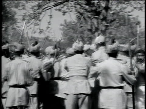 stockvideo's en b-roll-footage met 1950s ts crowd of demonstrators pushing and shoving with crowd control military present / india - indiase leger