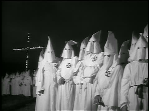 b/w 1950s pan crowd of members of ku klux klan with burning cross in background at night / georgia - ku klux klan stock videos and b-roll footage