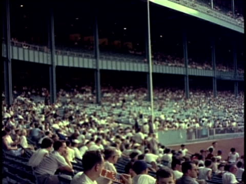 1950s ws pan crowd watching game at yankee stadium / new york, new york, usa - reportage stock videos & royalty-free footage