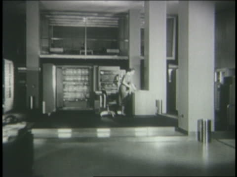 b/w 1950s dolly shot in woman working in huge computer room - mainframe stock videos & royalty-free footage