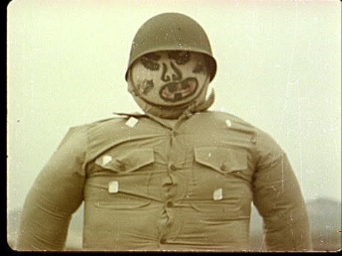 vidéos et rushes de 1950s ms dummy soldier with painted face at camp desert rock at nevada test site / nye county nevada usa - rock face