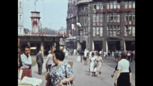 1950s eastern germany, richard wagner platz, place with many people / brühl at the corner to große fleischergasse, view to the building, where later... - east germany stock videos & royalty-free footage