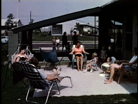 1950s families visiting at a neighborhood party outside a home / levittown, pennsylvania, united states - levittown pennsylvania stock videos and b-roll footage