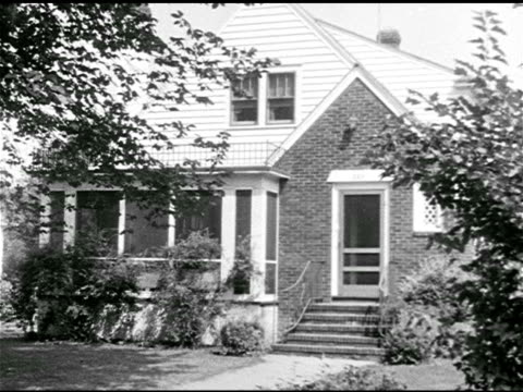 1950s family: dramatization: neighborhood houses. norton' home. 'mrs norton' calling from bottom of stairs, 'dinner's ready.' ham operator 'chris... - stay at home mother stock videos & royalty-free footage