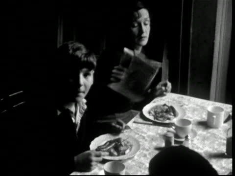 1950s family eating full English breakfast, old pint milk bottle on table