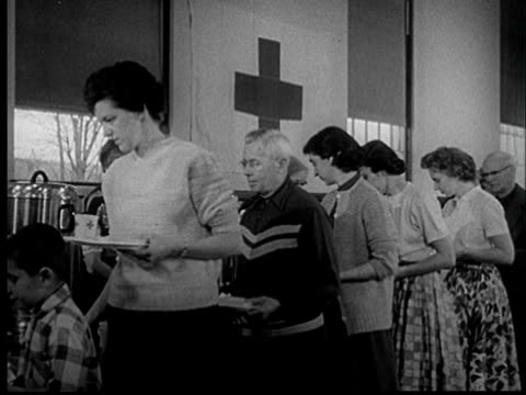 """1950s film montage ms pan people waiting in line for food at red cross disaster relief kitchen/ ha ms people in line for food/ st. louis, missouri"" - red cross stock videos & royalty-free footage"